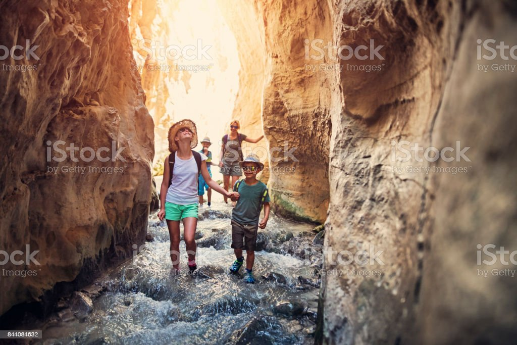 Family hiking through rivier in Andalusia, Spain - fotografia de stock