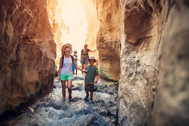 Family hiking through rivier in Andalusia, Spain stock photo