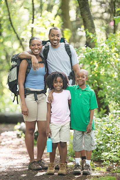 Family Hiking Through the Woods Together stock photo