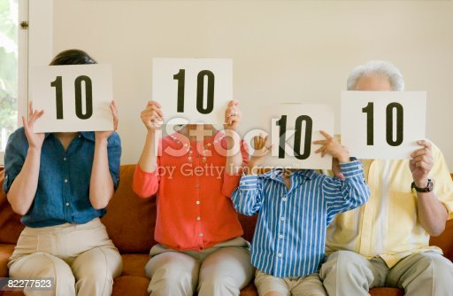 istock Family holding '10' cards in front of faces 82277523