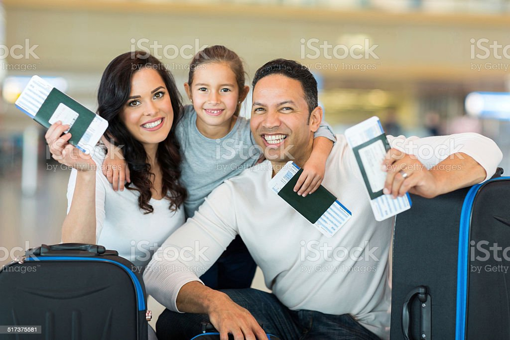 family holding boarding pass and passport stock photo