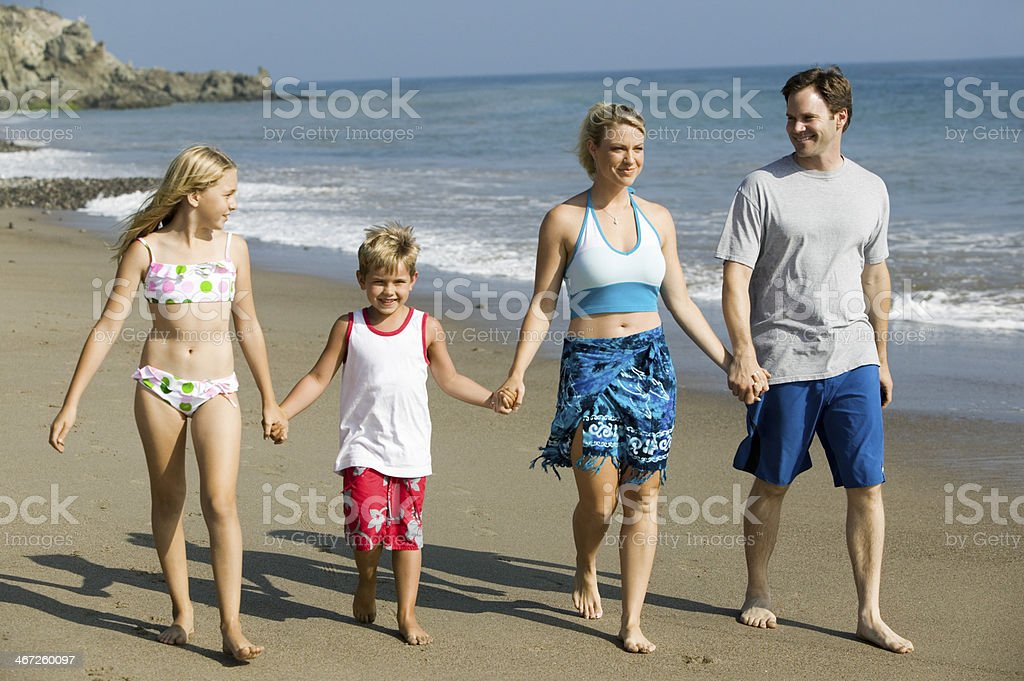 Family Holding Hands on Beach stock photo