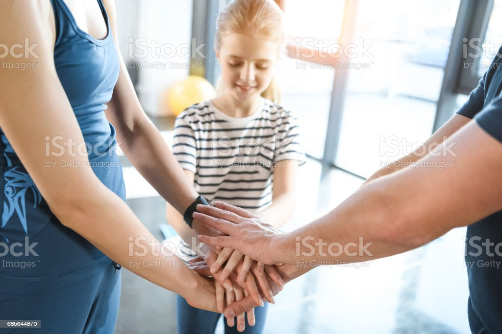 Family holding hands together at fitness center 免版稅 stock photo
