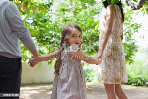 135384905 istock photo Family holding hands together outdoors 135384905