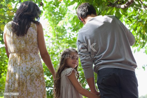 135384905 istock photo Family holding hands together outdoors 169075669
