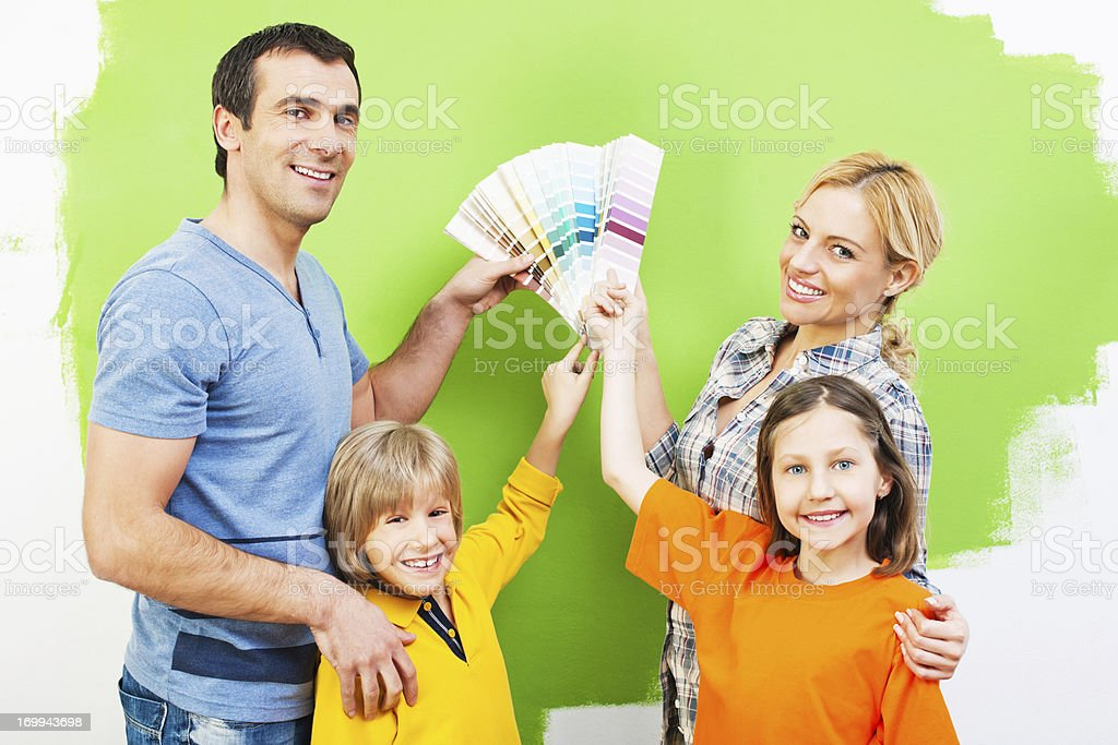 Family holding paint swatches. royalty-free stock photo