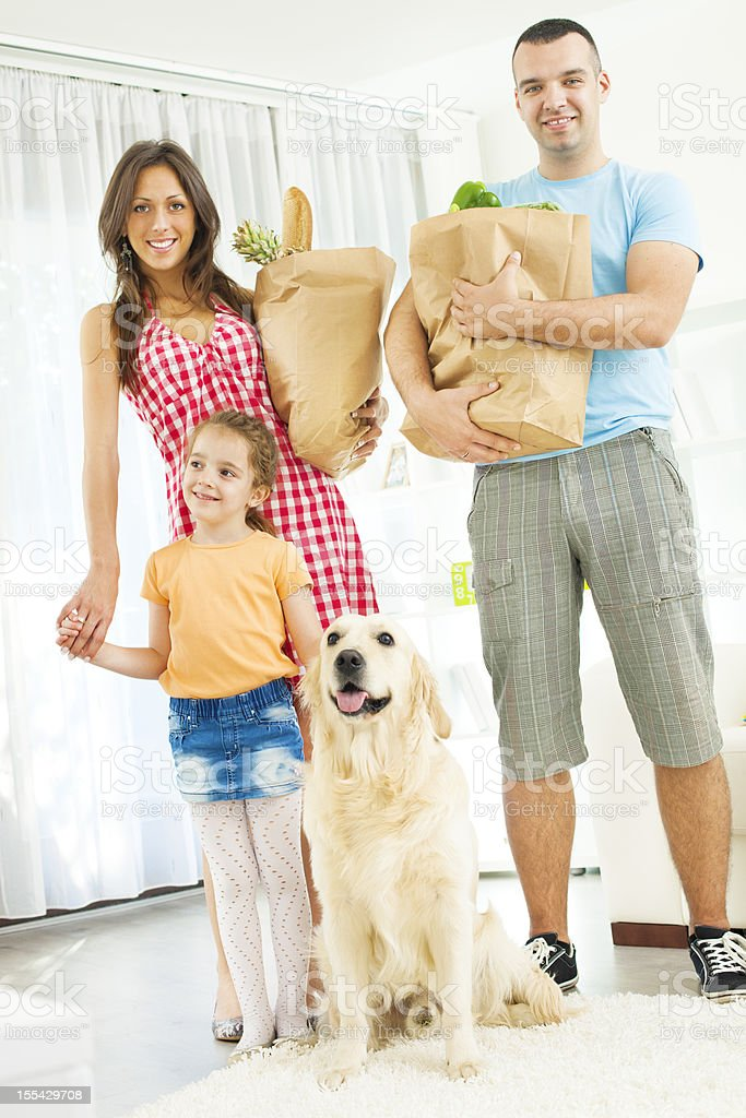 Family Holding Paper Shopping Bags with groceries royalty-free stock photo