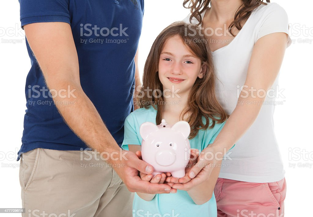 Family Holding Piggy Bank stock photo
