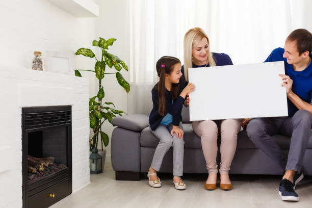 family holds holds photo canvas at home stock photo