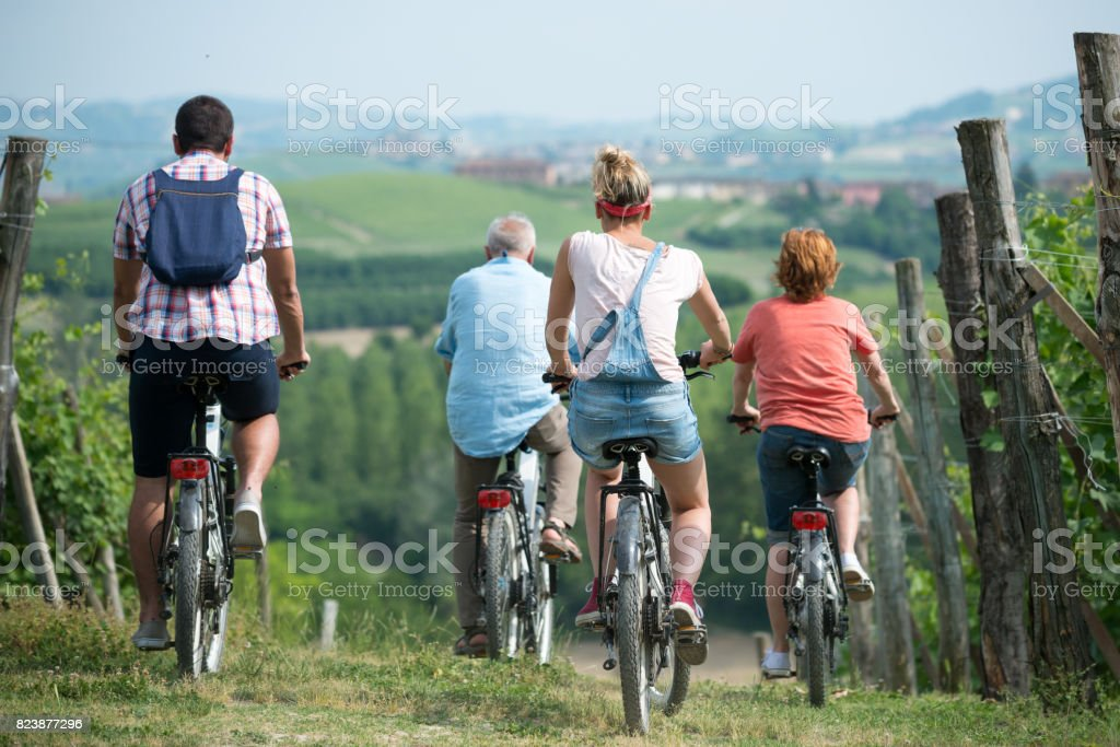 Family holidays in Langhe region, Piedmont, Italy: Electric bikes trip in the hills stock photo
