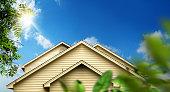 istock family home exterior over sunny blue sky 1210745012