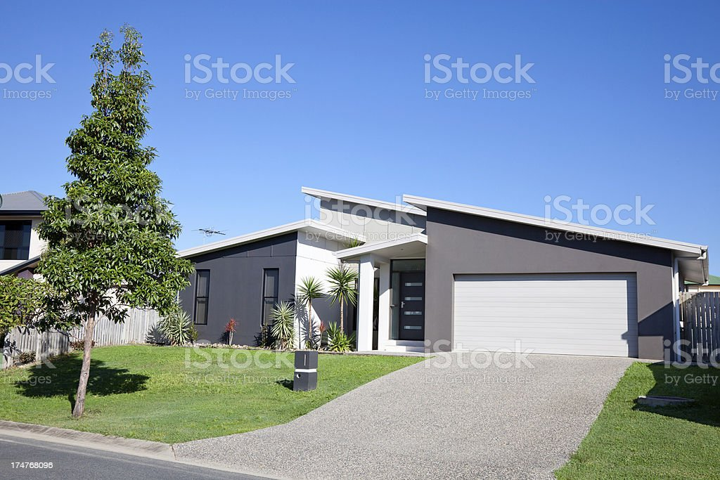 Family Home Front with blue sky stock photo