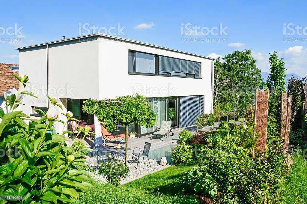 Contemporary rectangular style house, flat roof, under blue sky....