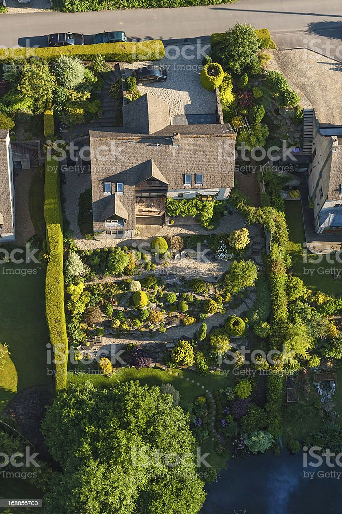 Family homes and green summer gardens aerial photo stock photo
