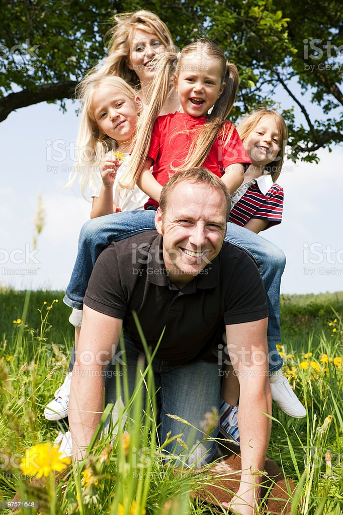 Family horse riding daddy royalty-free stock photo