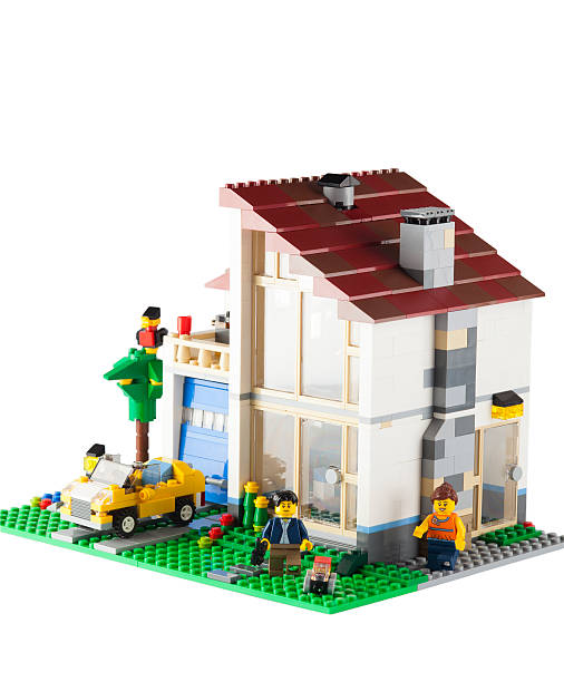 lego family house - lego house stock photos and pictures
