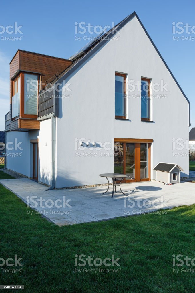 Family house with paved patio stock photo
