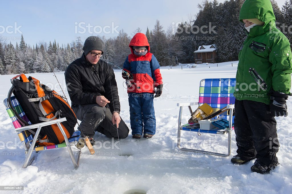 Family ice fishing stock photo