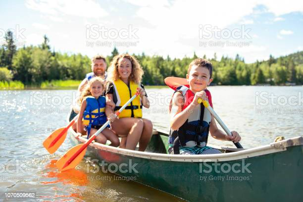 Photo of Family in a Canoe on a Lake having fun