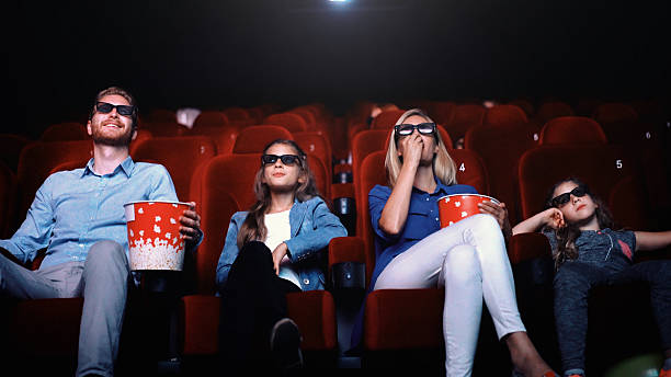 Family in a movie theater. stock photo
