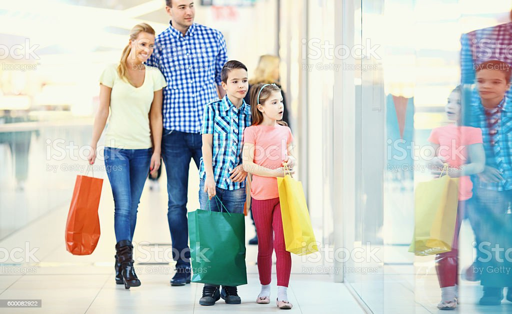 Family in a shopping mall. stock photo