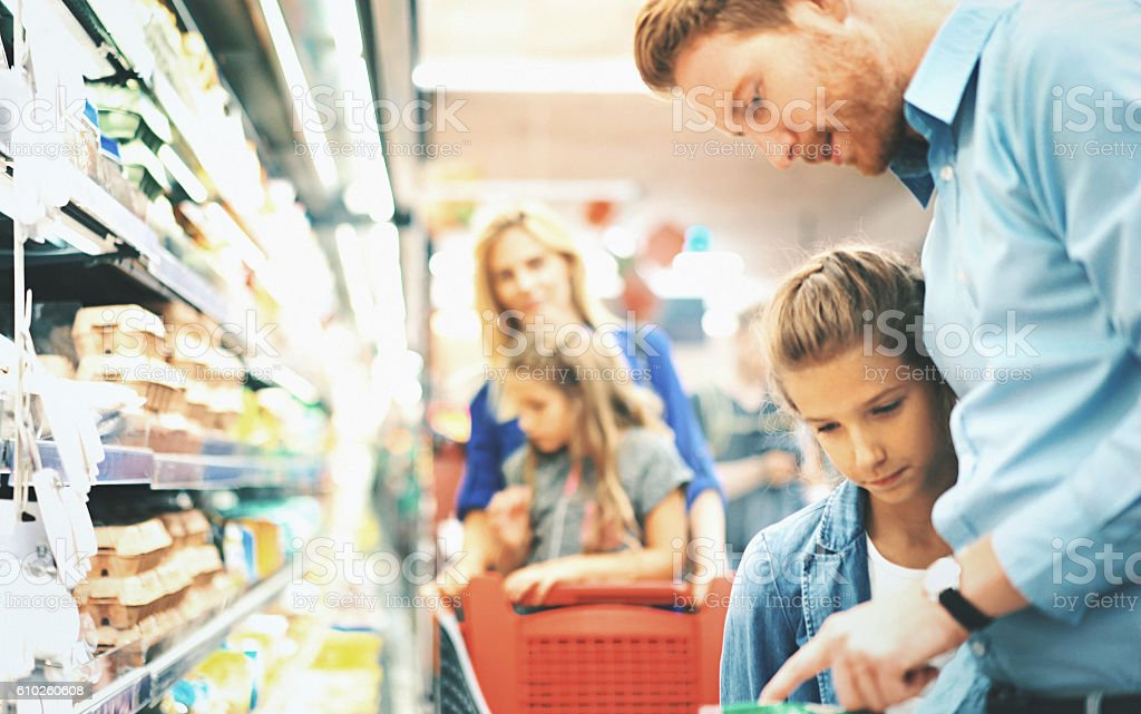Family in a supermarket. stock photo