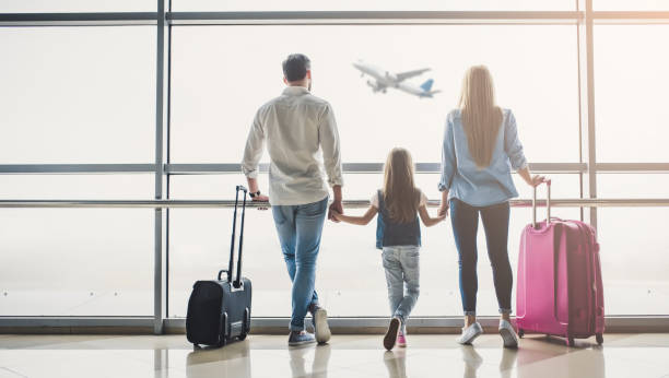 family in airport - travel stock pictures, royalty-free photos & images