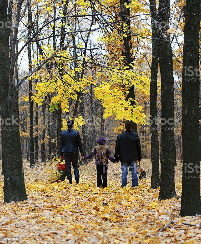 Family in autumn forest royalty-free stock photo