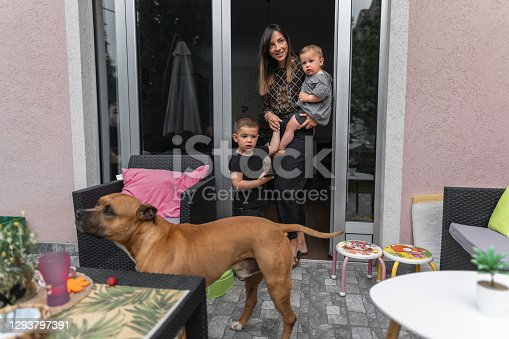 istock Family in back yard with dog 1293797391