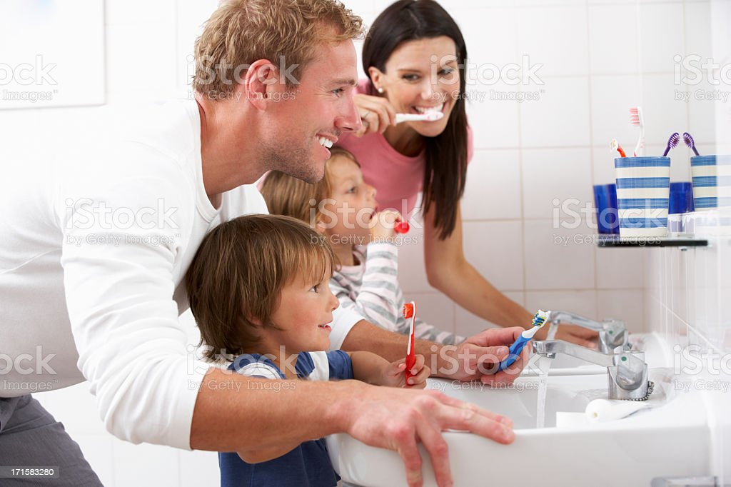 Family In Bathroom Brushing Teeth stock photo
