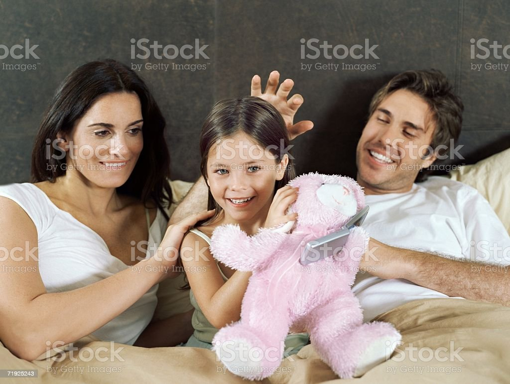 Family in bed royalty-free stock photo