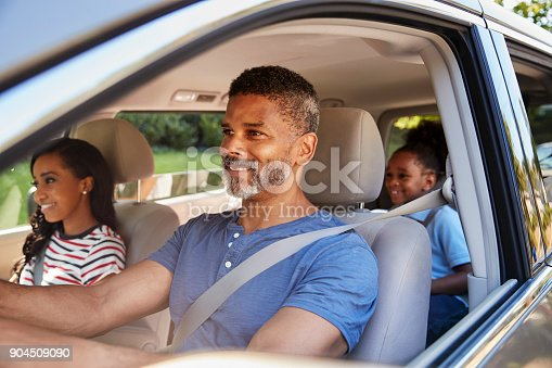 istock Family In Car Going On Road Trip 904509090