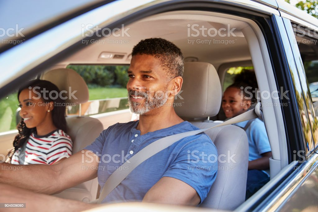 Family In Car Going On Road Trip stock photo