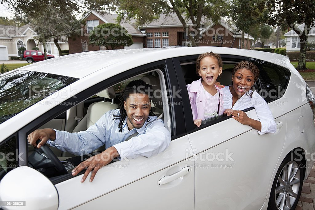 African American family with little girl in car.