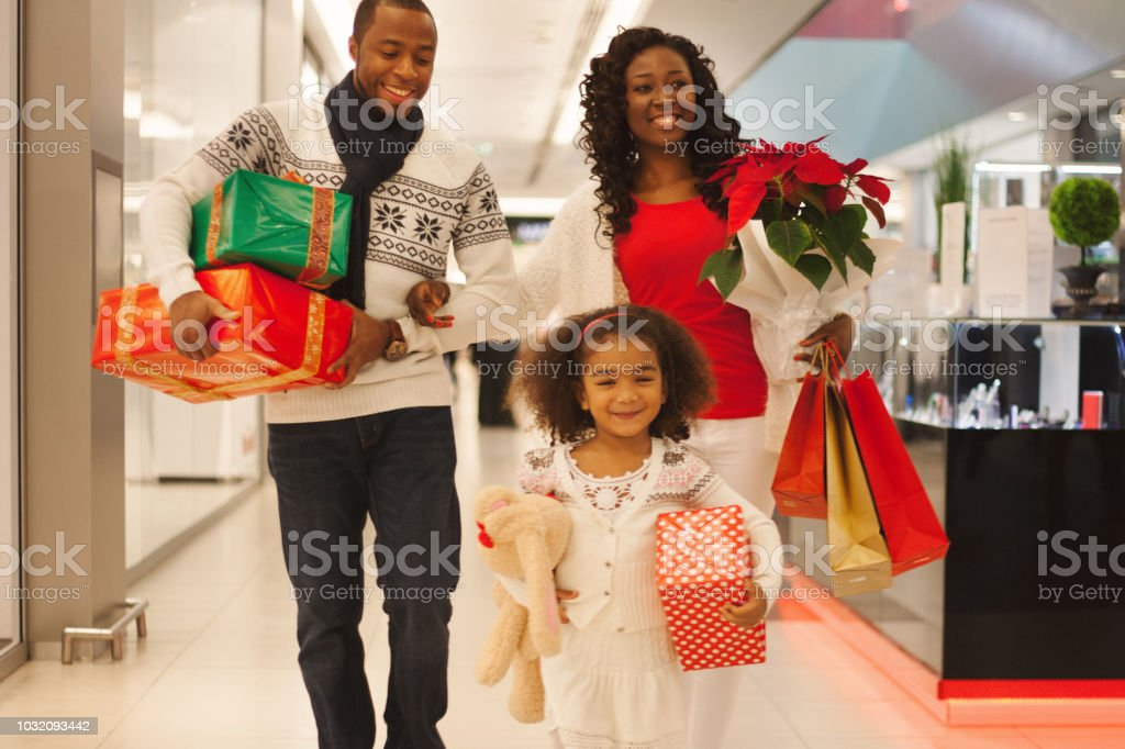 Family in Christmas shopping in mall