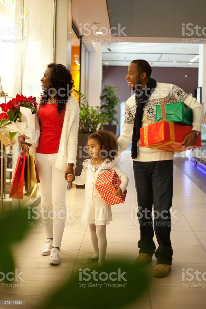 Happy family in Christmas shopping at shopping mall