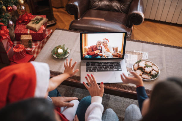 Family in Christmas video call.
