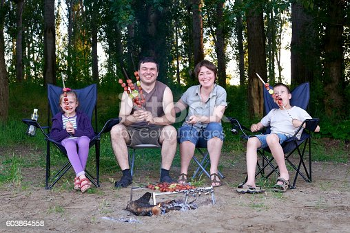 696841580 istock photo family in forest on picnic, make barbecue, meat cooked 603864558