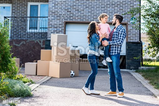 istock family in front of new house 881481728