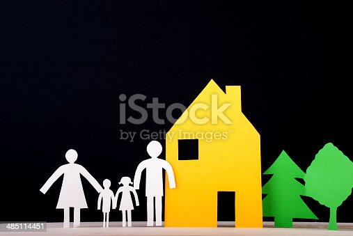958039576istockphoto Family in front of their House 485114451