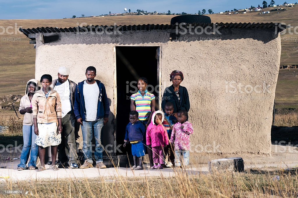 Family in front of there hut stock photo