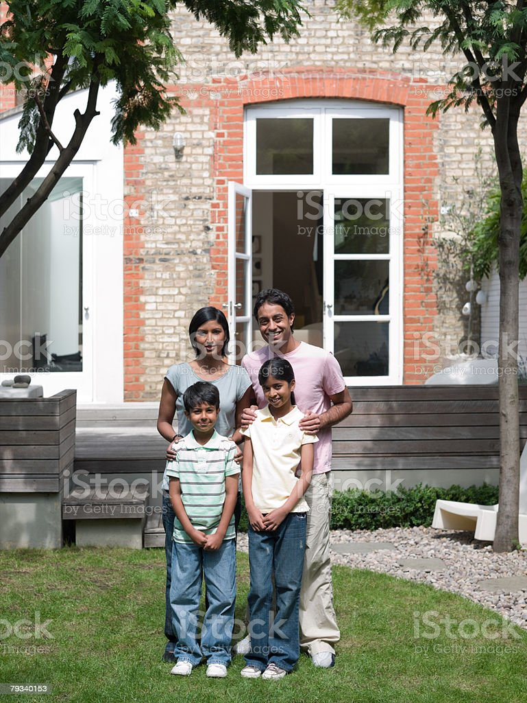 Family in garden 免版稅 stock photo