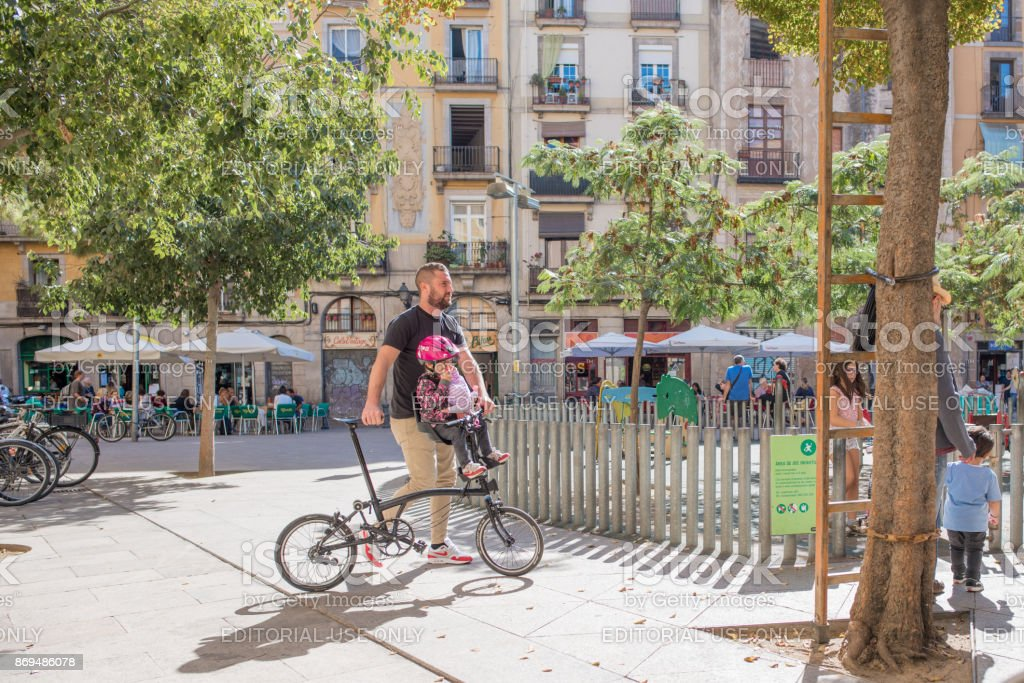 A family in George Orwell Plaza in Barcelona stock photo