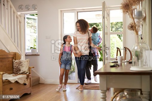 670900812istockphoto Family In Hallway Returning Home Together 613765326
