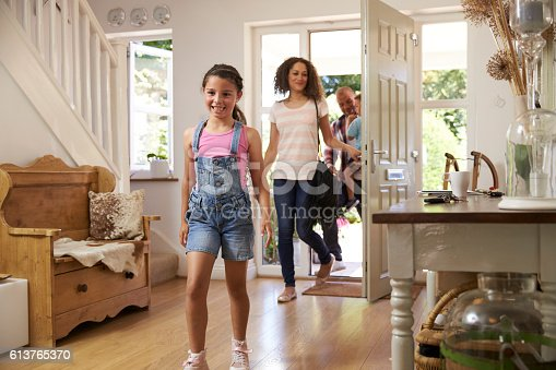 670900812istockphoto Family In Hallway Returning Home Together 613765370