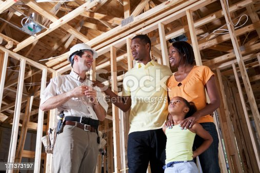 643843490istockphoto Family in house under construction with builder 171373197