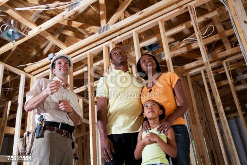 643843490 istock photo Family in house under construction with builder 175612554