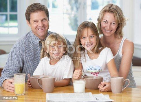 istock Family in kitchen having breakfast 79364925