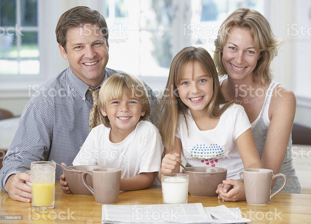 Family in kitchen having breakfast stock photo