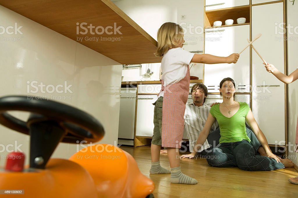 Family in kitchen, playing with children stock photo